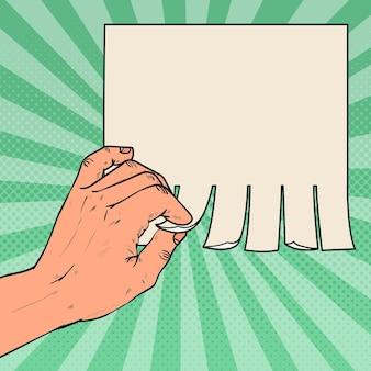 Mano maschile pop art strappare un pezzo di pubblicità in bianco.