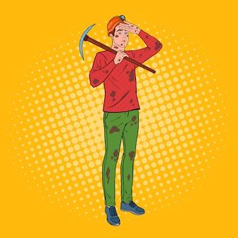 Pop art maschio minatore in casco con piccone