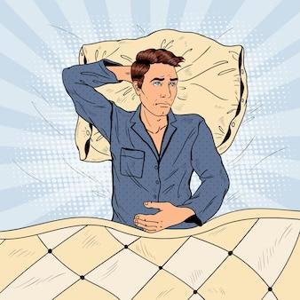 Uomo di pop art a letto che soffre di insonnia e insonnia