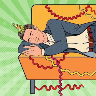 Pop art man dormire sul divano dopo la festa in ufficio aziendale. celebrazione del nuovo anno, compleanno.