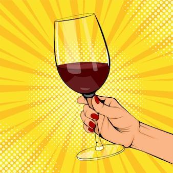 Le mani femminili del vecchio manifesto dell'annata di pop art tengono il bicchiere di vino rosso. mano della donna con la bevanda. evento wow festa di festa.