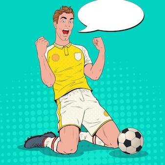 Giocatore di calcio di pop art che celebra obiettivo. calciatore felice, concetto di sport, coppa del mondo.