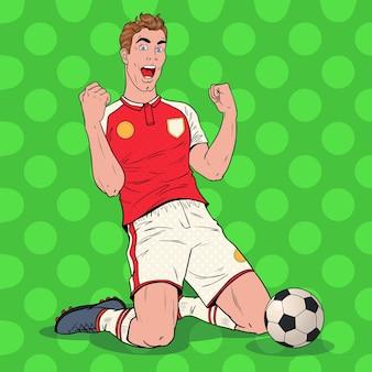 Giocatore di calcio di pop art che celebra obiettivo. calciatore felice, concetto di sport.