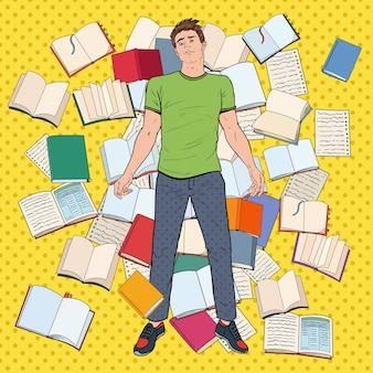 Pop art studente stanco sdraiato sul pavimento tra i libri. giovane sovraccarico di lavoro che prepara per gli esami. concetto di educazione.