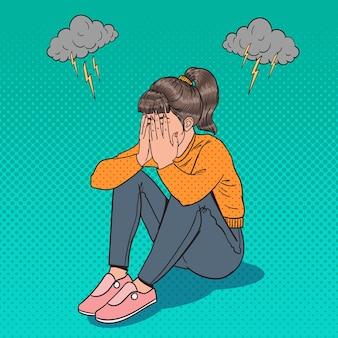 Pop art sconvolto giovane ragazza seduta sul pavimento. donna piangente depressa. stress e disperazione.