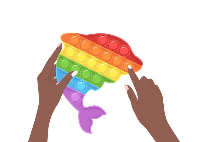 Fallo scoppiare. giocattolo sensoriale alla moda in mani femminili africane.