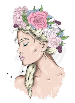 Ritratto di una bella ragazza in una corona di fiori