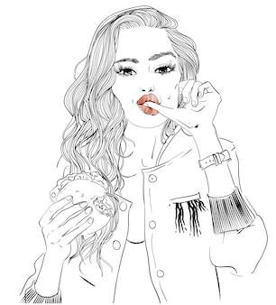 Ritratto di giovane donna con hamburger nelle sue mani
