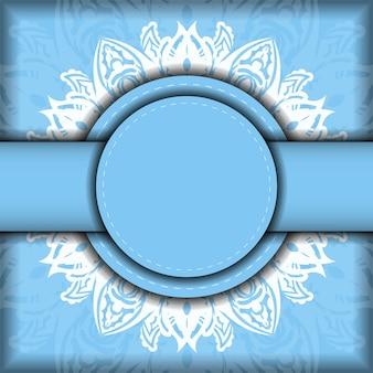 La cartolina è azzurra con un vecchio motivo bianco ed è pronta per la tipografia.