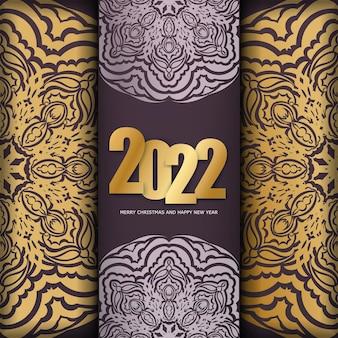 Modello di cartolina 2022 buon natale colore bordeaux con ornamenti d'oro di lusso