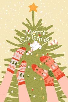 Poster cartolina di natale capodanno con calzini gatto e albero albero e gambe d'inverno dei cartoni animati modelli