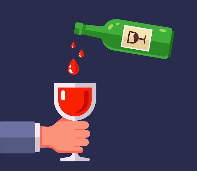 Versare il vino rosso da una bottiglia in un bicchiere