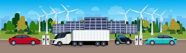 Centrale elettrica con i vechicles che caricano sopra le trecce del vento e le pile del pannello solare concetto amichevole elettrico dell'automobile di eco