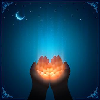 Le mani in preghiera del fedele musulmano ricevono la grazia di dio. visuale in prima persona. splendido splendore della luce divina. arte con cornice islamica. modello scalabile con uno spazio di copia per le citazioni religiose.