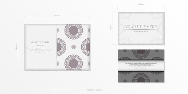 Preparare un invito con un posto per il tuo testo e ornamenti vintage. modello lussuoso per cartoline di design di stampa in colore bianco con motivi greci scuri.