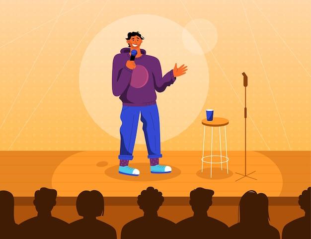 Comico professionista sul palco di stand up comedy show.