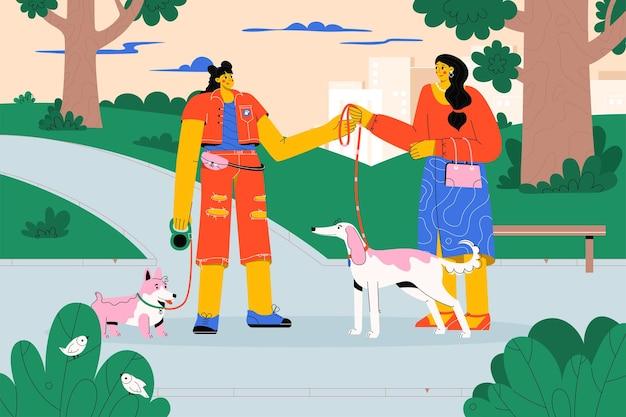 Camminatore professionale dell'animale domestico che prende cane al guinzaglio