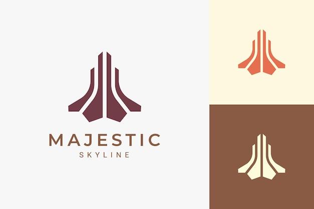Logo di proprietà o appartamento per immobili in forma astratta e di lusso