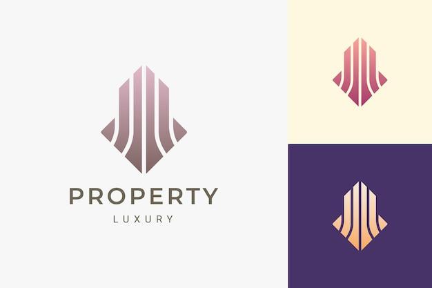 Logo di proprietà o edificio per immobili in forma di lusso e astratta