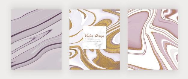 Inchiostro liquido viola con carte glitter oro e cornice in marmo.