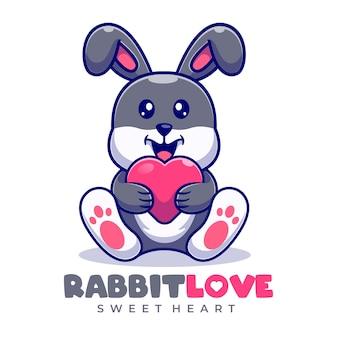 Modello di logo del fumetto della mascotte di amore del coniglio