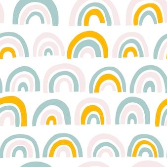 Rainbow seamless pattern in colori pastello.
