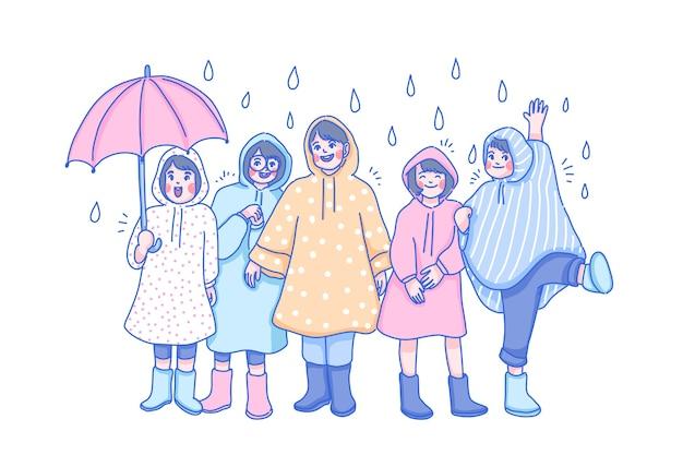 Stagione piovosa. i bambini giocano sotto la pioggia.