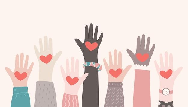 Mani alzate che fanno volontariato concetto di associazione di beneficenza mani multirazziali con cuori che si alzano