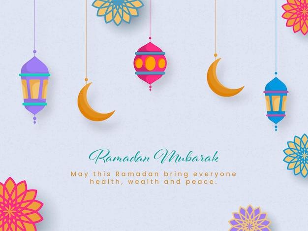 Carattere ramadan mubarak con lanterne appese