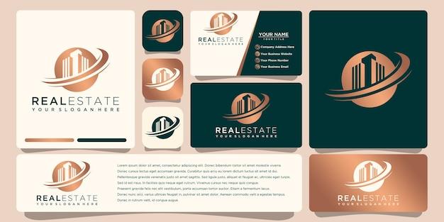 Design del logo oro immobiliare con biglietto da visita