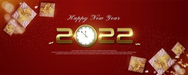 Banner realistico di felice anno nuovo 2022 con numero d'oro e icona dell'orologio