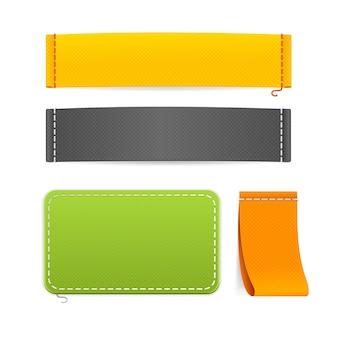 Set di etichette di abbigliamento in tessuto realistico. diverse dimensioni e colori pronti per il tuo design.