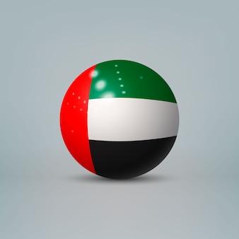 Sfera di plastica lucida realistica con la bandiera degli emirati arabi uniti