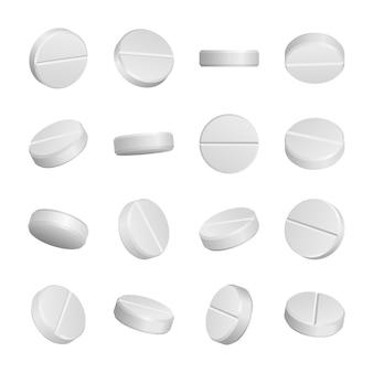 Pillole mediche realistiche isolate su bianco.