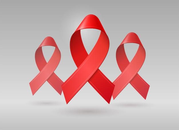 Nastri rossi realistici per la giornata mondiale dell'aids. dicembre simbolo di consapevolezza dell'hiv.