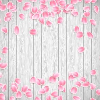 Petali di sakura realistici su un fondo di legno bianco.