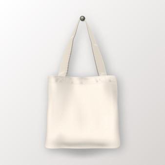 Tote bag in tessuto vuoto bianco realistico di vettore. primo piano isolato su sfondo bianco. modello di progettazione per il branding, mockup. eps10 illustrazione.