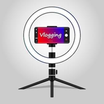 Registrazione vlog utilizzando il cellulare con treppiede luce anulare per il concetto di vlogging