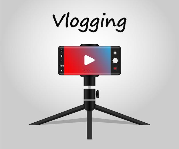 Registrazione di vlog tramite cellulare con treppiede concetto di vlogging