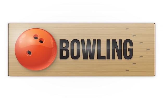 Palla rossa sul vicolo per il gioco del bowling