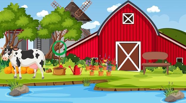 Fienile rosso nella scena della fattoria con una mucca