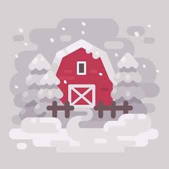 Granaio rosso con gli abeti in un paesaggio invernale innevato