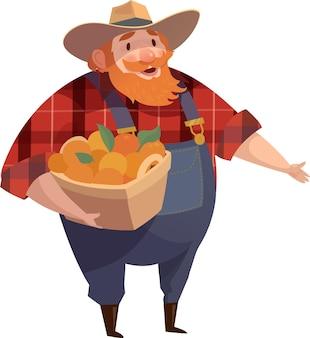 Barba rossa uomo-agricoltore che indossa denim con secchio di frutta.