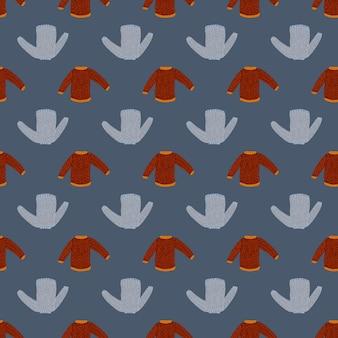 Modello senza cuciture di doodle del maglione lavorato a maglia rosso e blu.