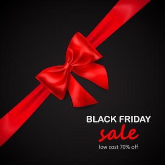 Fiocco rosso con nastro diagonalmente con ombra e scritta black friday sale su sfondo nero