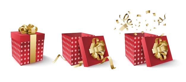 Scatola rossa con nastro d'oro e coriandoli isolati su priorità bassa bianca.