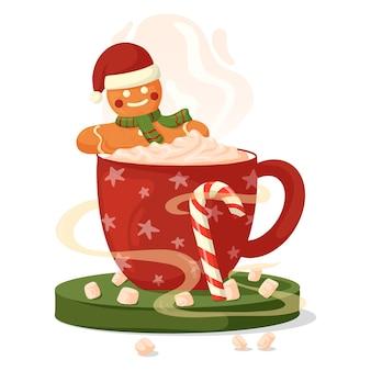 Tazza di caffè rossa con crema, marshmallow e omino di pan di zenzero.