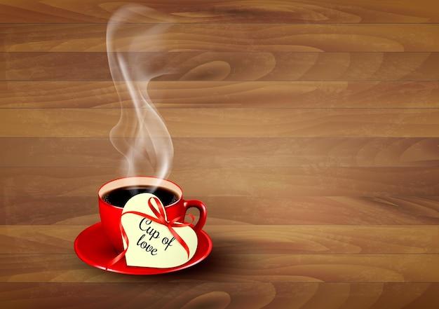Tazza di caffè rossa con una nota di san valentino a forma di cuore su fondo di legno. vettore.