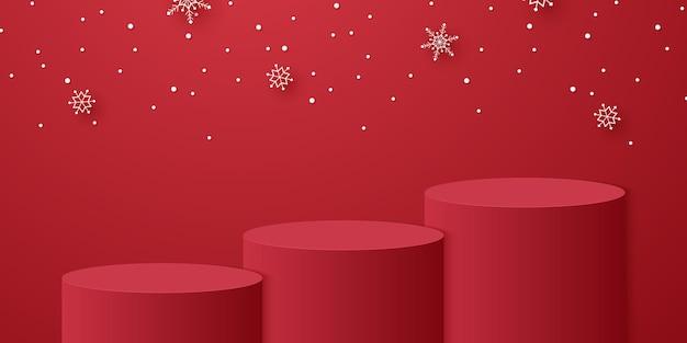 Podio cilindrico rosso con fiocchi di neve che cadono e modello di modello per l'evento di natale