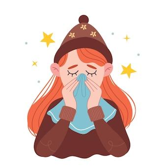 Una ragazza dai capelli rossi con un caldo cappello marrone si soffia il naso in un fazzoletto. ragazza che starnutisce nel tessuto. la giovane donna ammalata a casa.